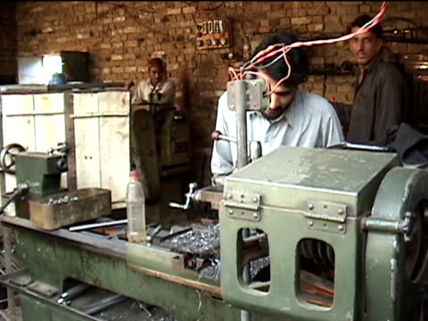 ms three men working in gun making factory federally administered tribal areas pakistan audio - only mid adult men stock videos & royalty-free footage