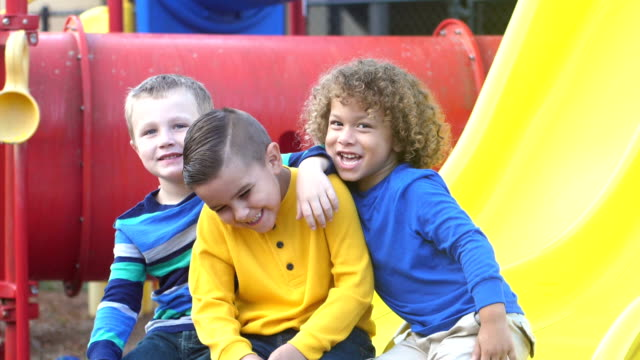 three mischievous boys on playground - preschool stock videos & royalty-free footage