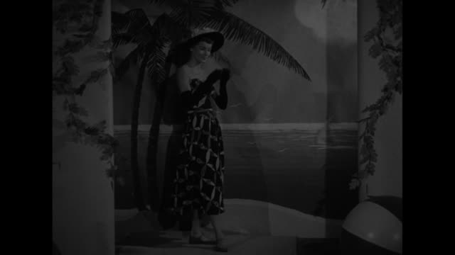 three models in bathing suits, one steps forward and walks off camera / model displays bathing suit, walks to camera / model wearing hat and gloves... - washing up glove stock videos & royalty-free footage