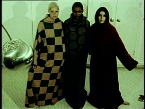 three models wearing rudi gernreich designed outfits that look like blankets or an early version of a snuggie 1970s fashions on january 01 1971 in... - {{asset.href}} stock videos & royalty-free footage