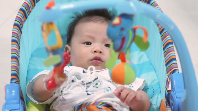 stockvideo's en b-roll-footage met three months baby and toys - alleen één jongensbaby