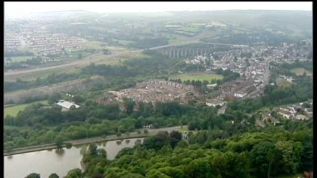 Three more die in Legionnaires' disease outbreak WALES town in South Wales valley Rooftops of houses seen across fields