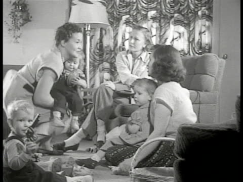 levittown pennsylvania visiting three mothers w/ babies in living room play date bathing baby mother taking baby to sink for bath mother bathing baby... - levittown pennsylvania stock videos and b-roll footage