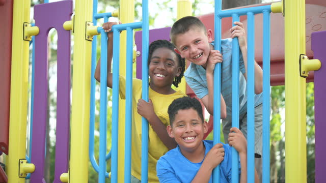 three multi-ethnic boys playing on playground - 8 9 years stock videos & royalty-free footage