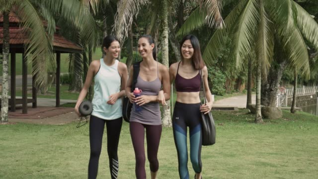 three multi-ethnic friends walking to park for the yoga class - small group of people stock videos & royalty-free footage