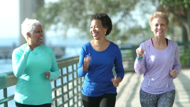 Three multi-ethnic mature and senior women exercising