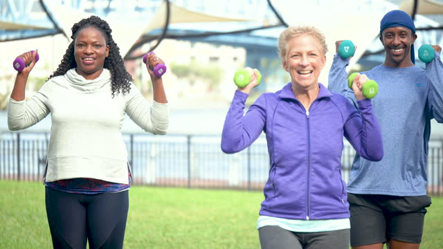 three multi-ethnic people exercising outdoors, lunges - 60 69 years stock videos & royalty-free footage