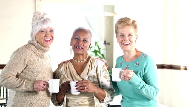 Three multi-ethnic senior women talking to camera