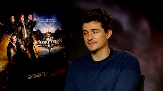 'three musketeers' film released interviews with cast england london int orlando bloom interview sot on playing a bad guy on advice given by coactors... - orlando bloom stock videos & royalty-free footage