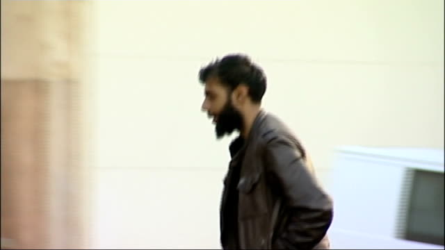 three muslim men found guilty of anti-gay hate crime; england: derbyshire: derby: ext ihjaz ali arriving at derby corwn court split screen - slow... - letterbox stock-videos und b-roll-filmmaterial