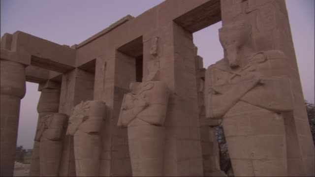 three of four statues at an ancient egyptian ruin are missing heads. - decapitated stock videos & royalty-free footage