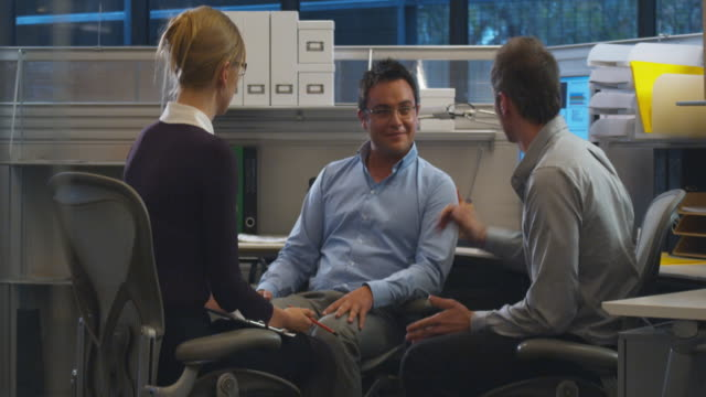 ms three office workers discussing, sydney, australia - female with group of males stock videos & royalty-free footage