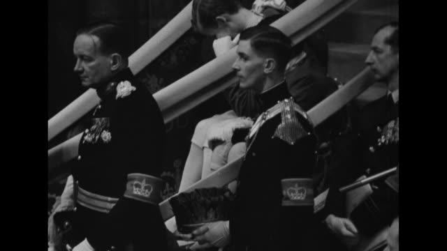 ms three officers wearing fulldress uniforms and armbands with crown - coronation of queen elizabeth ii stock videos and b-roll footage
