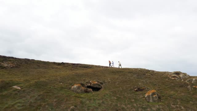 three old men hiking on cliff path - effort stock videos & royalty-free footage