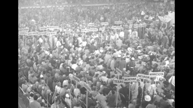 Three overhead shots of delegates gathered on convention floor / General Douglas MacArthur with group of men walking through delegates towards...