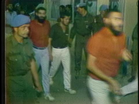 three palestine liberation organization prisoners of war kneel and kiss the ground during an israeli-arab prisoner exchange. - israel stock videos & royalty-free footage