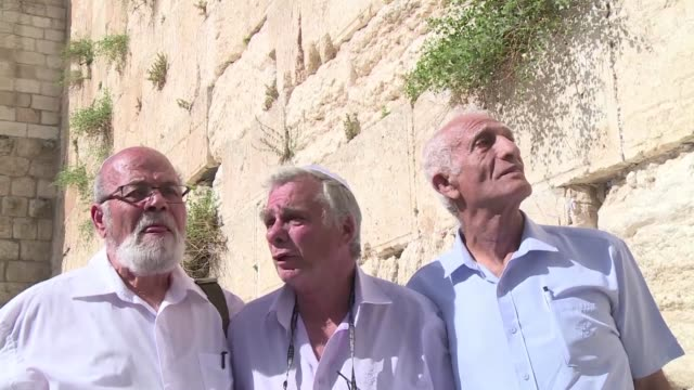 three paratroopers in an iconic photograph of israel's capture of the wailing wall in jerusalem's old city during the 1967 sixday war have recreated... - six day war stock videos and b-roll footage