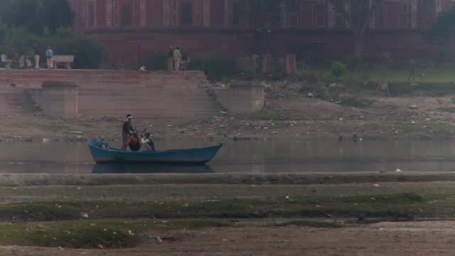 Three people in Boat on Yamuna river