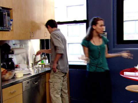 ms, pan, three people in office lunch room - 水周り点の映像素材/bロール