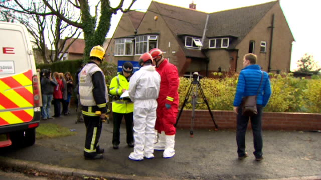 three people killed in house fire in bolton england greater manchester bolton ext firedamaged house and 'for sale' sign firefighters and forensic... - bolton greater manchester stock videos and b-roll footage