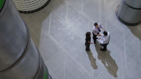 ws pan three people meeting n office hallway / orem, utah, usa - three people stock videos & royalty-free footage