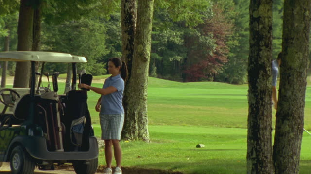 ms, pan, three people playing golf on golf course, seco, maine, usa - golf swing women stock videos & royalty-free footage