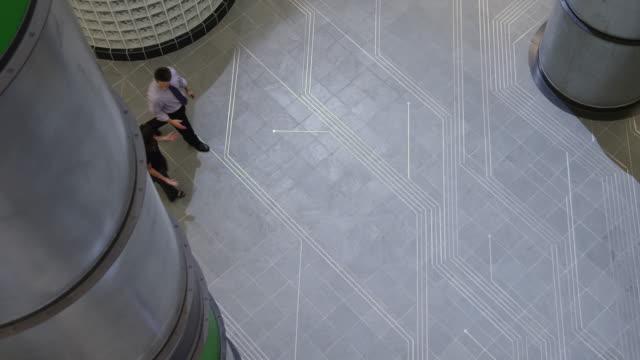 ws pan three people walking through office hallway / orem, utah, usa - orem bildbanksvideor och videomaterial från bakom kulisserna