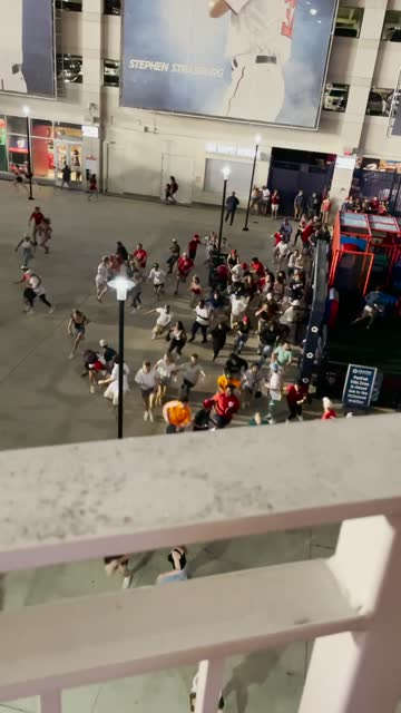 three people were injured when https://www.fox5dc.com/news/washington-nationals-game-halted-after-shooting-outside-stadium gunfire erupted outside... - nationals park stock videos & royalty-free footage