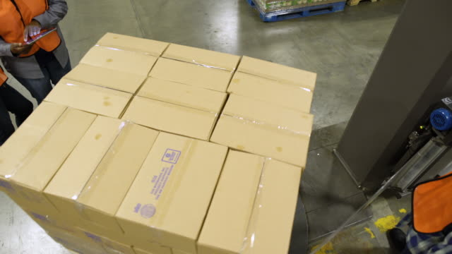 three people working in a warehouse - packaging stock videos & royalty-free footage