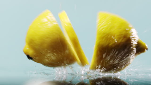 three pieces of lemon falling down - peel stock videos & royalty-free footage