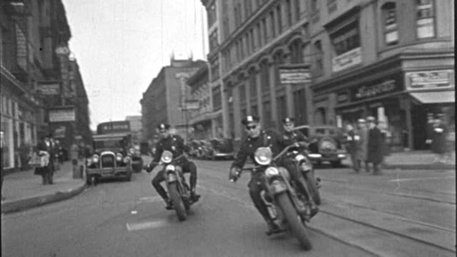 three police officers ride motorcycles through times square in new york city. - 1937 stock videos & royalty-free footage