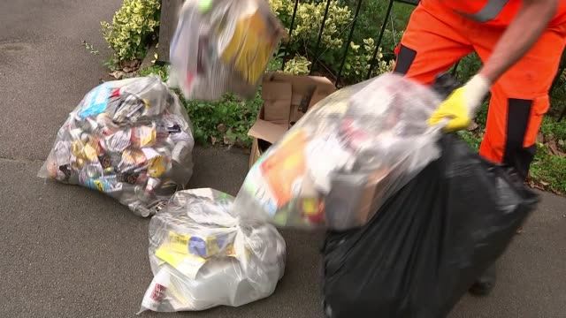 three quarters of councils turning away from outsourcing public services to private companies; uk, kent, sevenoaks; refuse collectors putting bags of... - outsourcing stock videos & royalty-free footage