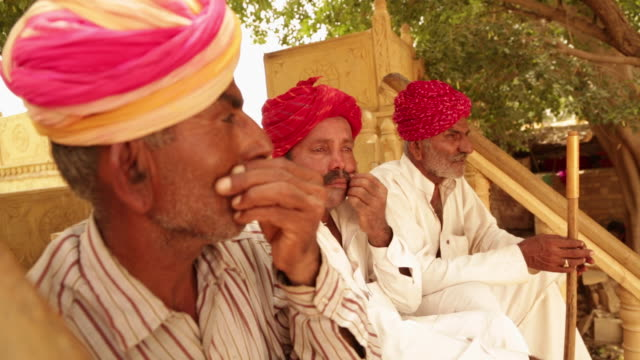 three rajasthani senior men showing masculinity, jaisalmer, rajasthan, india - masculinity stock videos & royalty-free footage