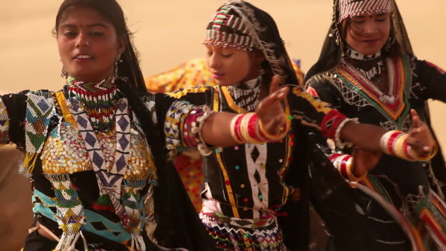 three rajasthani women dancing on desert, sam desert, jaisalmer, rajasthan, india - traditional ceremony stock videos & royalty-free footage
