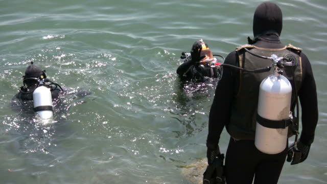 (HD1080i) Three Rescue Divers Enter Water