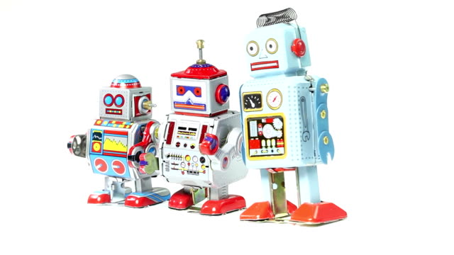 three retro tin toy robot - loopable - three objects stock videos & royalty-free footage