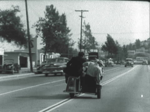 montage three riders on a motorcycle with sidecar driving wildly through a town / los angeles, california, united states - sidecar stock videos & royalty-free footage