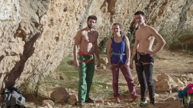 Three rock climber  getting ready to climb in the Pyrenees