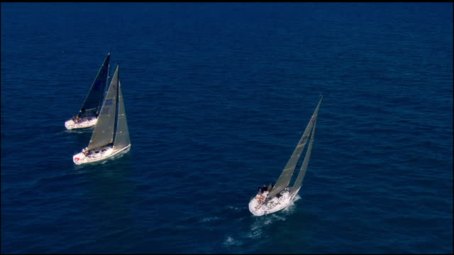 LOW AERIAL, Three sailboats in ocean, Key West, Florida, USA