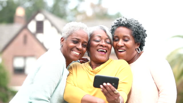 Three senior African American women taking a selfie