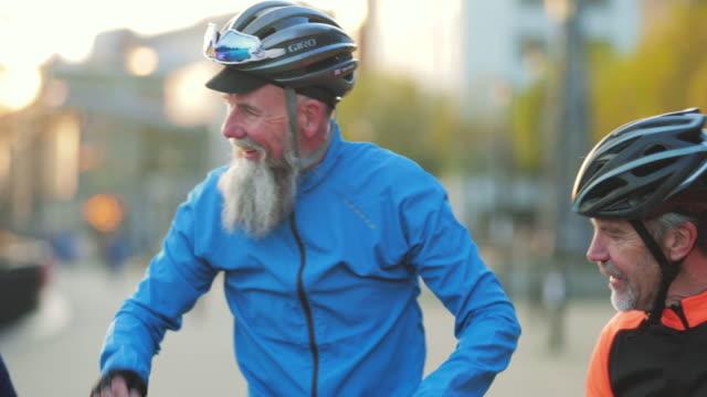 three senior cyclists having a break - road trip stock videos & royalty-free footage