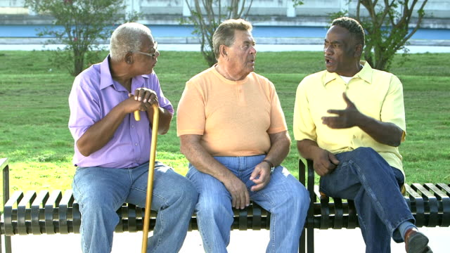 three senior men sitting on bench, talking - debate stock videos & royalty-free footage