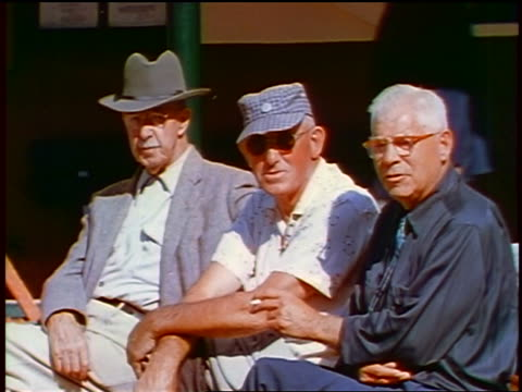 1957 three senior men sitting outdoors looking at camera / two in hats, one in sunglasses - 1957 stock videos & royalty-free footage