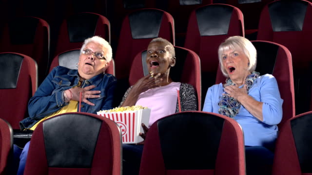 three senior women at the movies watching a horror film - movie theater stock videos & royalty-free footage
