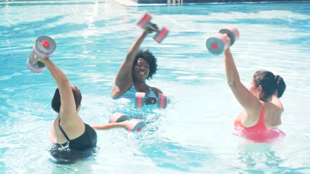 three senior women doing water aerobics - aerobics stock videos & royalty-free footage