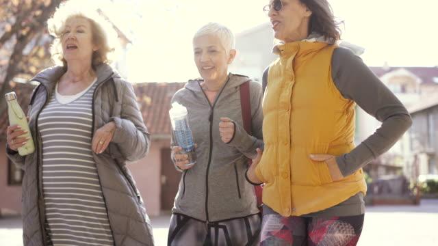 Three senior women leaving dance class
