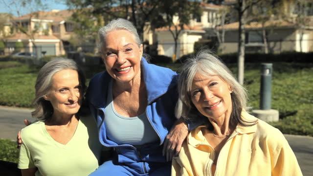 MS Three senior women smiling and posing / Los Angeles, California, USA
