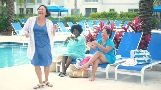 three senior women vacationing, dancing on pool deck - full length stock videos & royalty-free footage