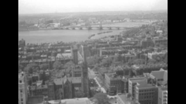vídeos y material grabado en eventos de stock de three shots from across charles river of barges in river and boston skyline / overhead shot of boston and charles river / overhead shot of boston and... - río charles