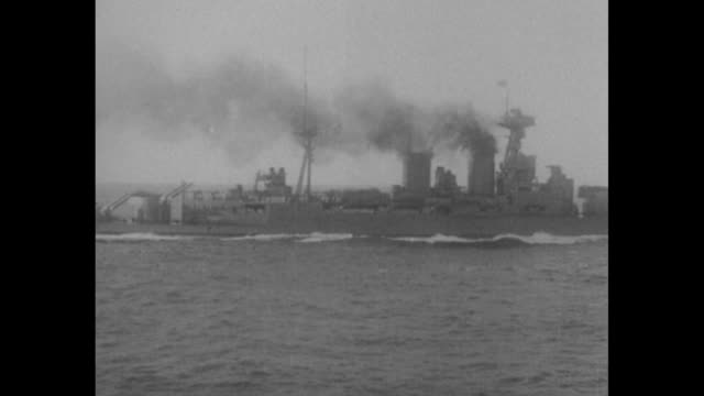 three pov shots from moving ship of warship steaming ahead / shot on board warship of sailors loading and firing antiaircraft guns / sailors elevate... - kriegsschiff stock-videos und b-roll-filmmaterial